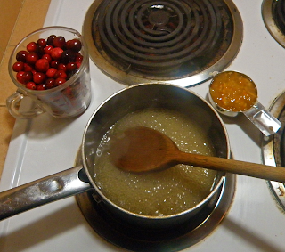Bubbling Sauce Before Adding Cranberries and Orange