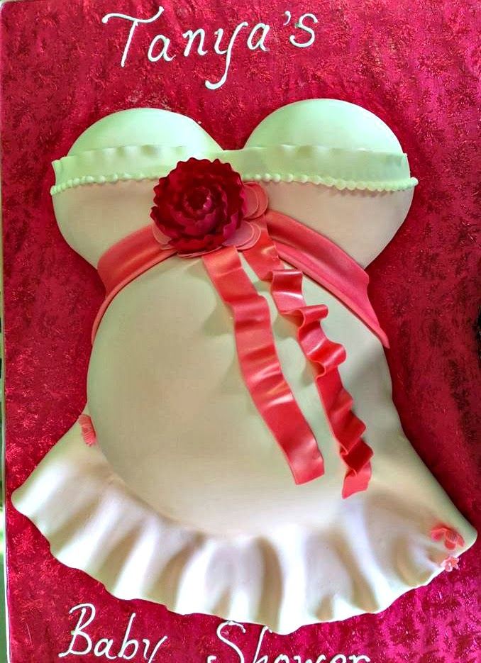 pink belly bump cake