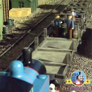 Thomas to the rescue of his railroad train friends with rail transport boxcars carrying fuel drums