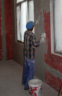 Sally on with the plastering
