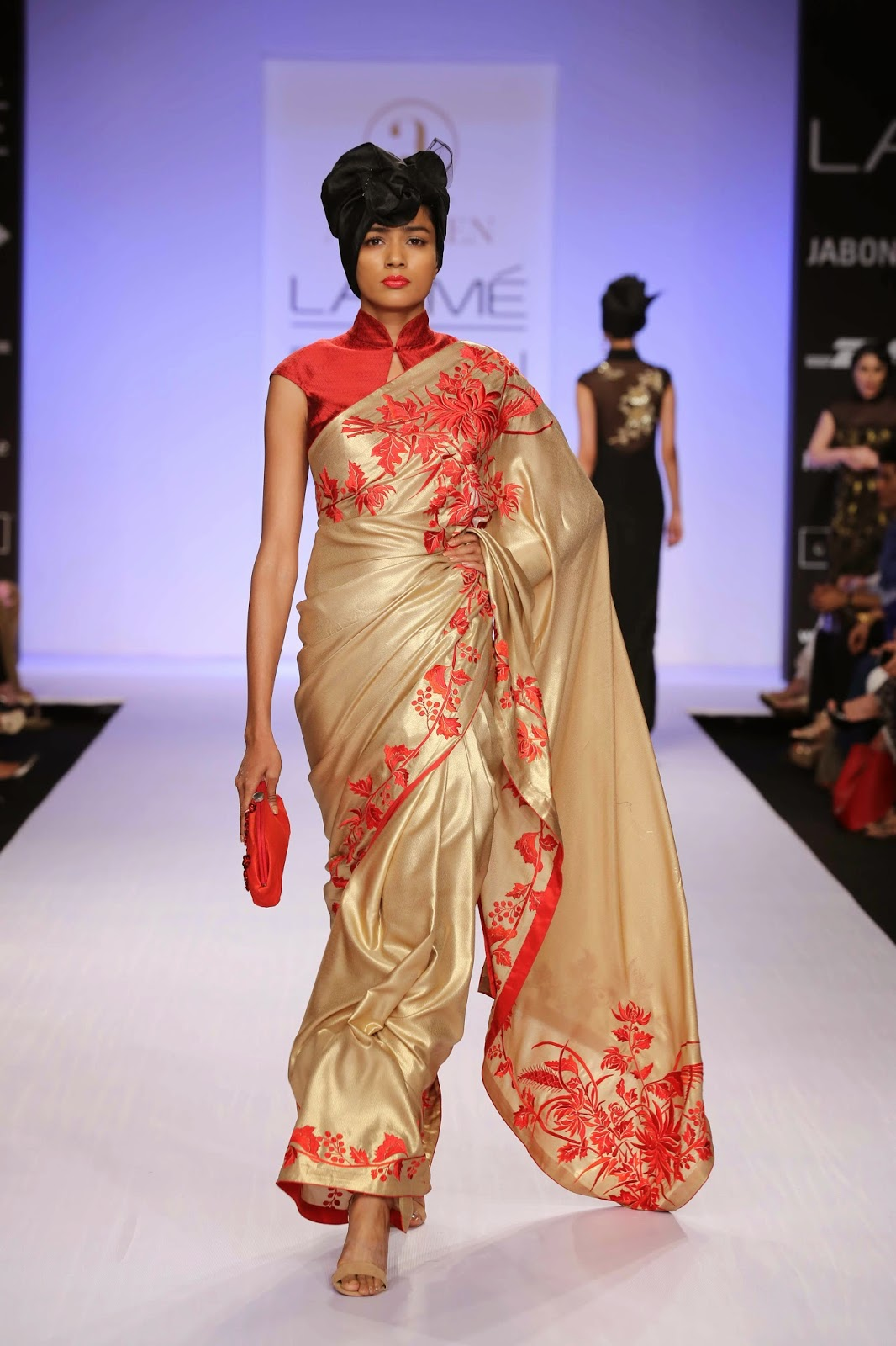 Silver pants with net layers were worn with sheer blouse, while a red sari with a majestic gold peacock on the pallav was gorgeous. The final black lace gown with shimmering sequins and multicoloured roses down the front was a superb end to a show of great elegance, style and innovative embellishment placements.