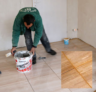 Bekir using the orange grout. The colour calmed as it dried.