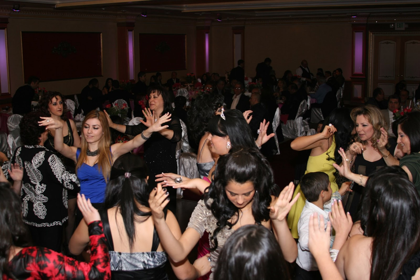 the n culture a large group of ns are dancing to shalaxo music at a traditional sweet 16 in n dance arms are always raised high and there is a lot of fast