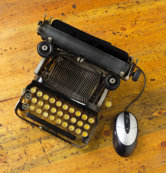 old fashioned typewriter with a modern mouse