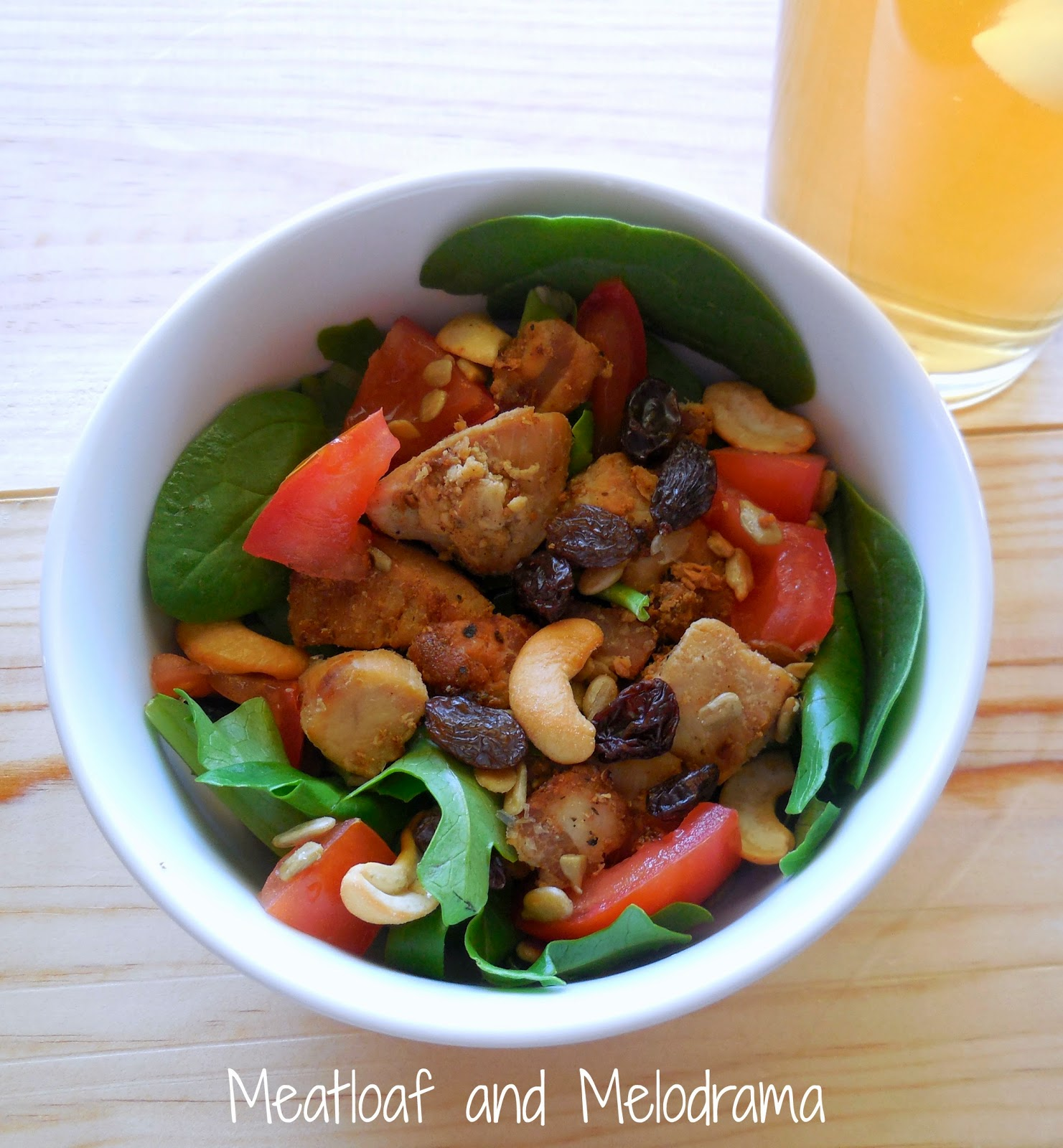 mixed salad greens topped with chicken bacon tomatoes raisins