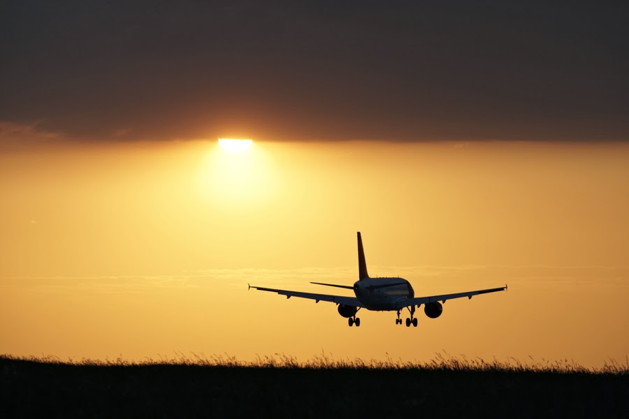 Plane landing in sunset