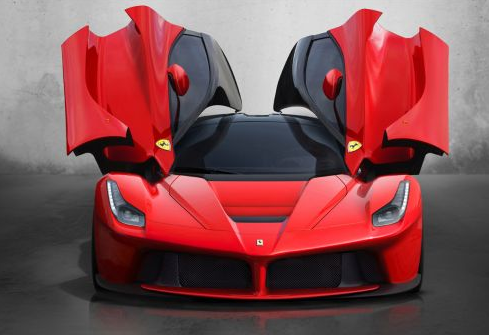 red ferrari laferrari sports car with beetle wing doors