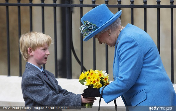 ueen Elizabeth II receives flowers as she leaves the Easter Sunday service at St George's Chapel at Windsor Castle
