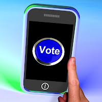 "Image of smart phone with the word ""Vote"" displayed on it"