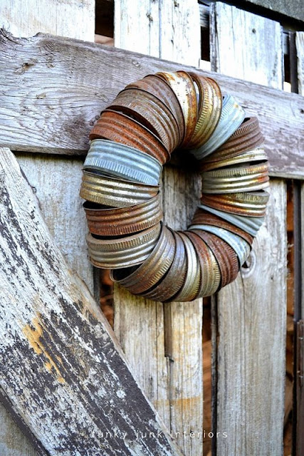 rusty canning jar lid wreath on shed / part of summer garden reveal on FunkyJunkInteriors.net