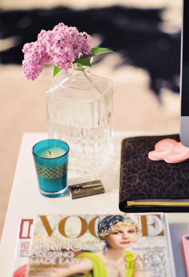 fresh lilacs on the edge of my desk, vogue magazines, candle, leopard print day planner