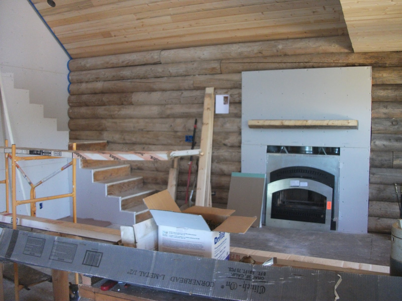 log cabin drywall and fire place mantel june 20 2012
