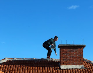 Carefully negotiating to the other roof