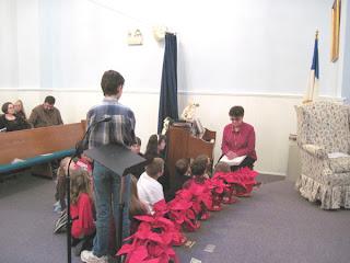 Laurel reads Scripture at Mt. Zion General Baptist Church