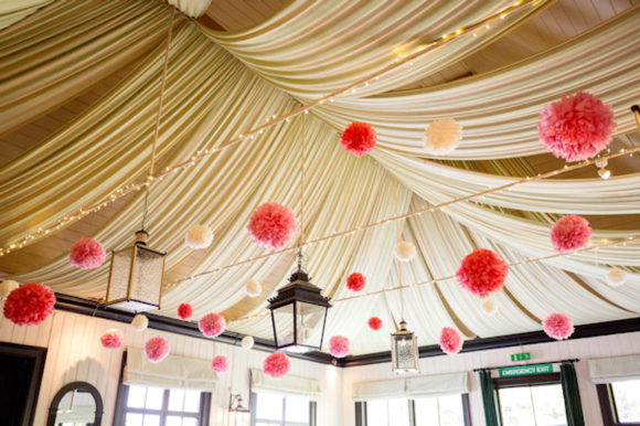 Wedding style guide image inspiration hang pom poms from for Hanging pom poms from ceiling