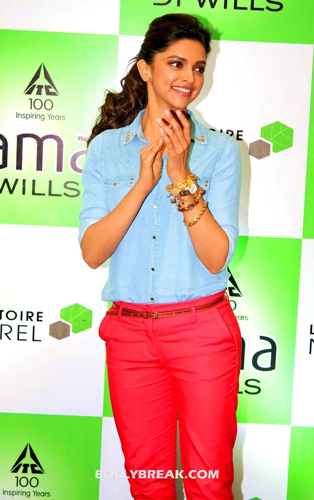 Deepika Padukone In red pants and a denim shirt -  Deepika Padukone Red pants photos