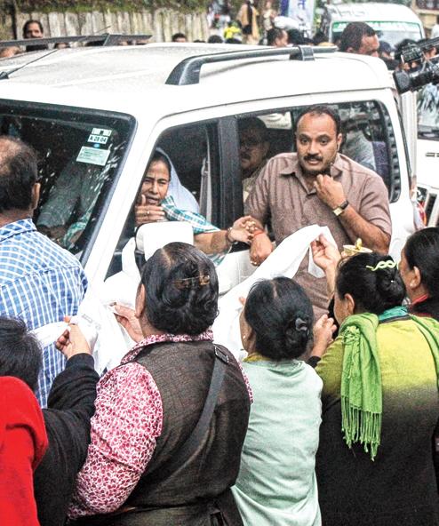 Members of the Bhutia community offer khadas to Mamata Banerjee in  Darjeeling on Monday