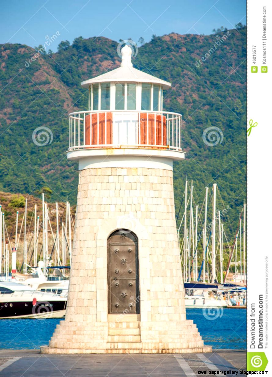 Beautiful Lighthouse On The Background Of Mountains Stock Photo