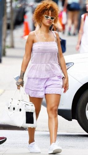 Rihanna Steps out Braless...(Photos)