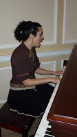 Unwoman graces us with a song on the hallway piano