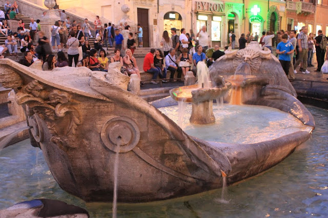 Fontana della Barcaccia with the design of a small boat on the fountain, is located in front of Spanish Steps in Rome, Italy