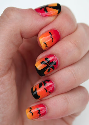 Sunset nail art with palm trees, birds and boat
