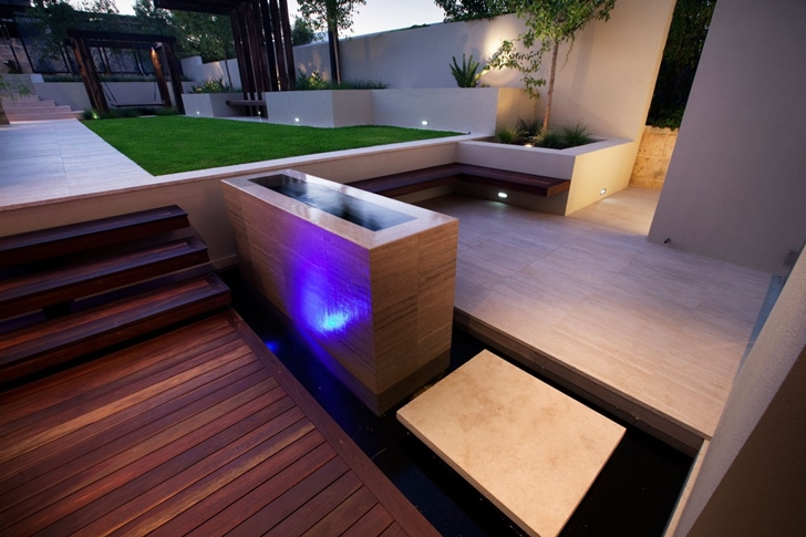 Wooden and concrete stairs in Modern backyard by Ritz Exterior Design