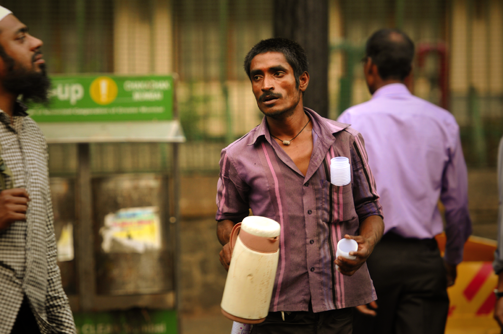 Bombay photo of an Indian man selling chai tea in India.