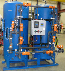 PVC tank caoting and PVC Face Piping that is attached to a two-bed demineralizer