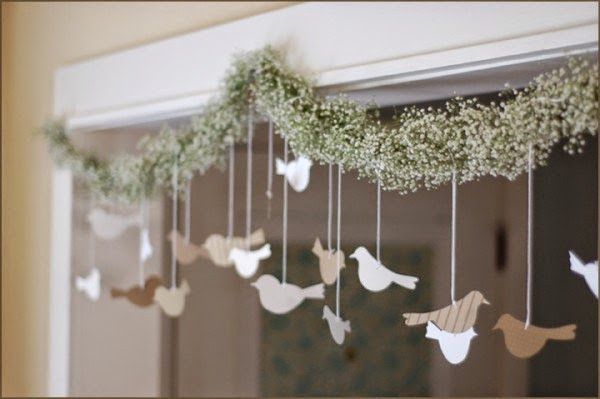 http://makezine.com/craft/how-to_bird_and_flower_garland/