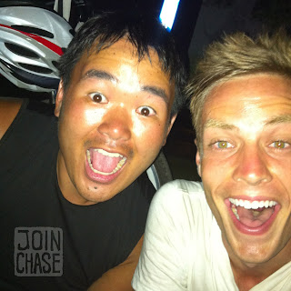 Two guys really excited about biking in South Korea.