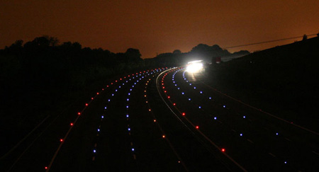 LED Cats-eyes along the M25 at dusk, marking out the road limits.