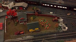 pumpkin patch and houses as part of model railroad