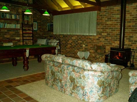 Lounge, wood fire heater, and billiard table