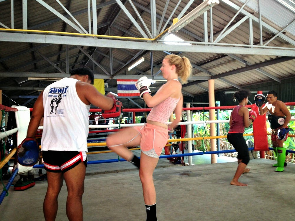 woman and instructor training Muay Thai martial art
