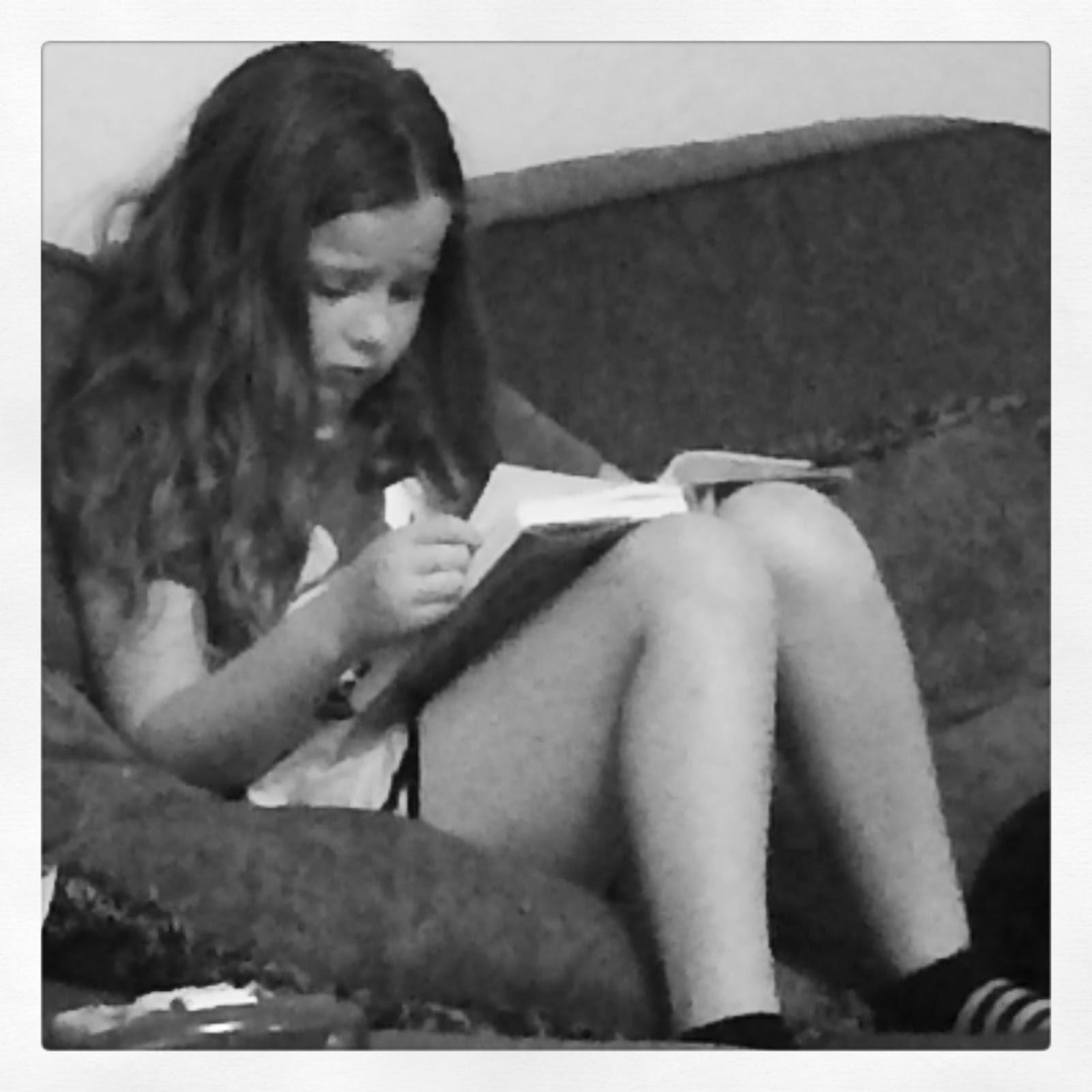 Tween girl reading
