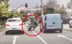 Road Rager On Scooter Kicks Car