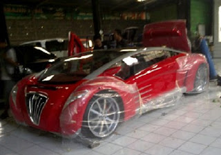 mobil listrik tuxuci
