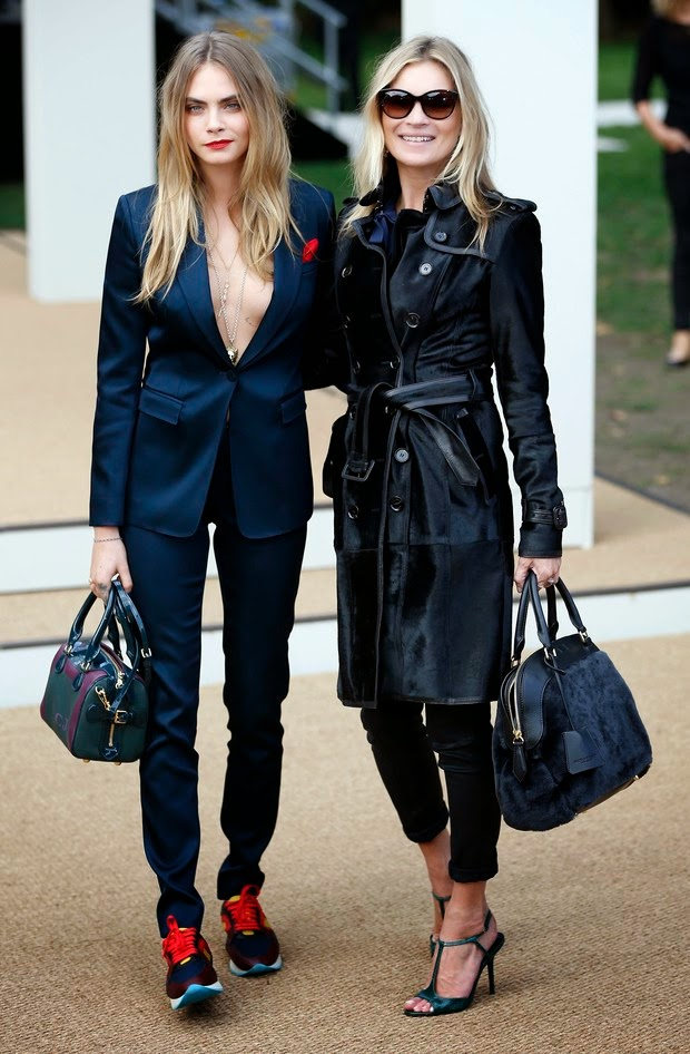 Cara Delevingne and Kate Moss attend the parade of Burberry Prorsum