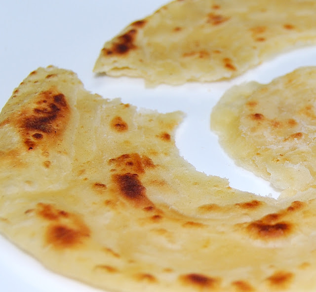Close up of a flaky khasta paratha
