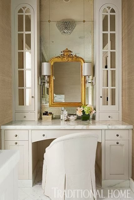 white master bathroom gold framed mirror white cabinets