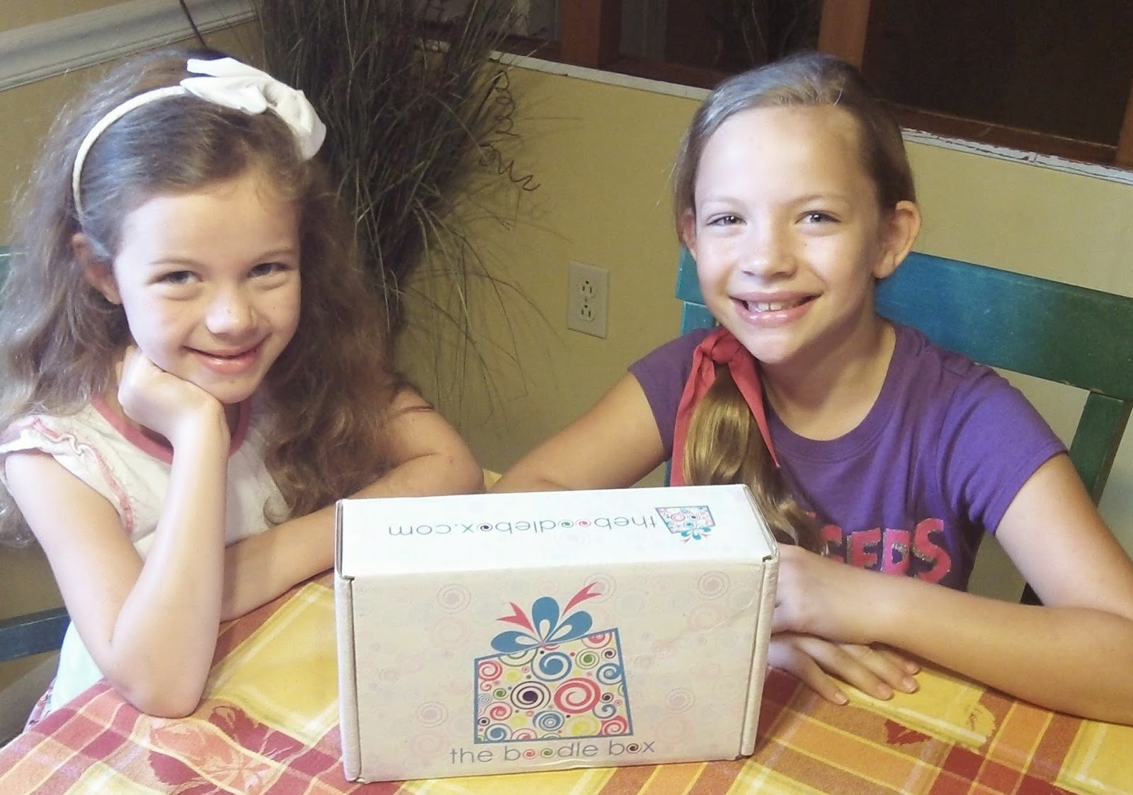 My girls are so excited to preview the June Boodle Box