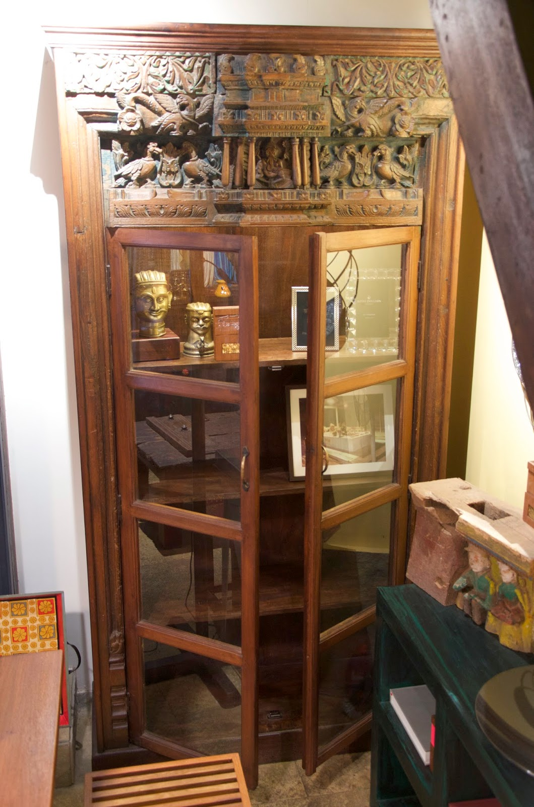 Incredible salvaged Burma teak door frame with intricate relief panel  incorporated above. Makes for a magnificent and unique book case. Rs 185,000 - BombayJules: Pondicherry (Mumbai) - New Antiques & Interiors Find!