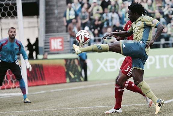 Seattle Sounders player Obafemi Martins shoots to score a goal against San Jose Earthquakes