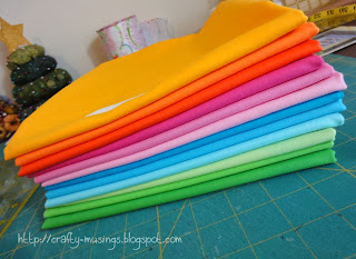 happy pile of bright colored Kona solids