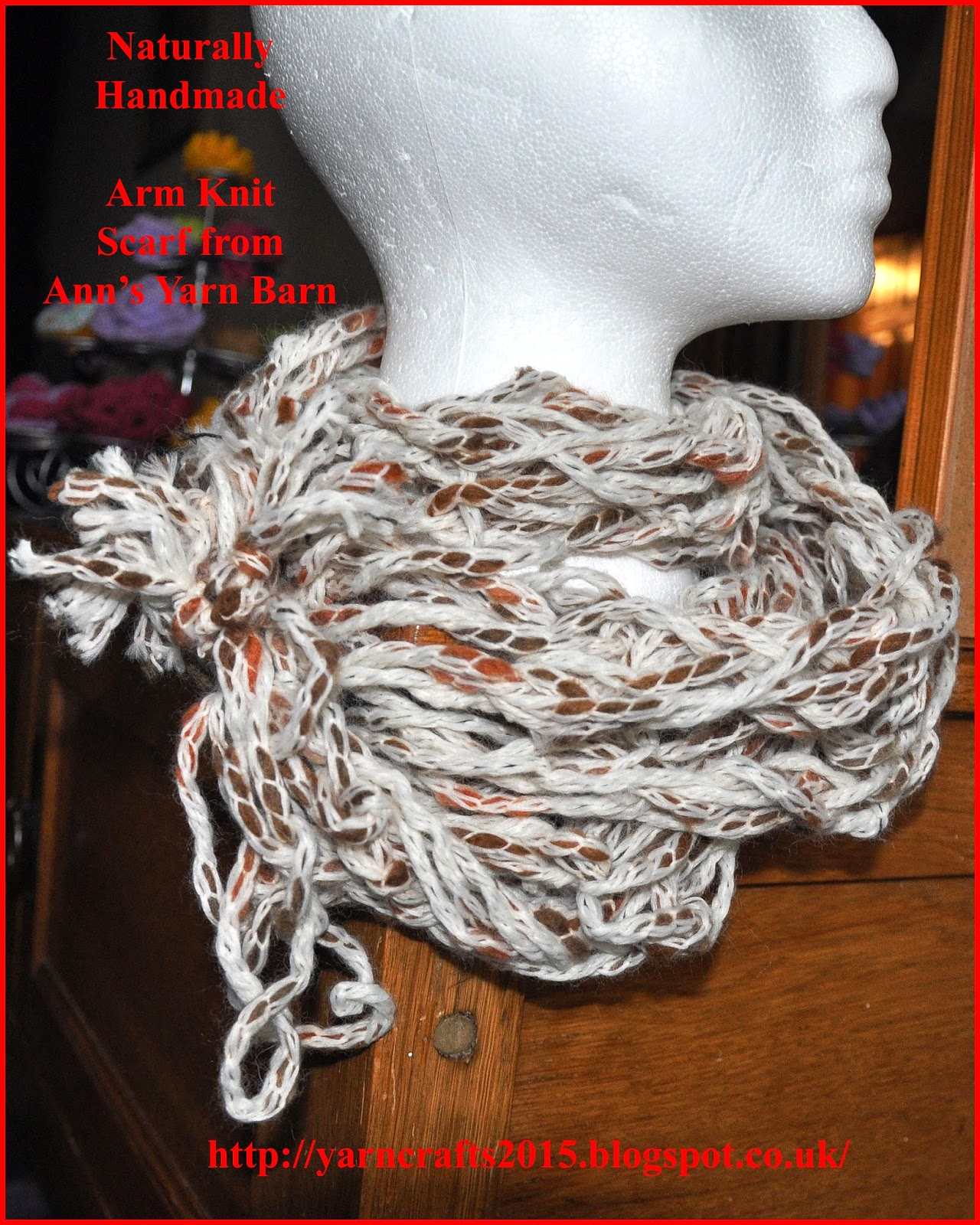 arm knitting scarf on manikin head