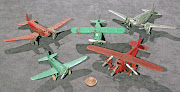 These airplanes are very small, as you can see from the penny placed . (tootsietoy airplanes )