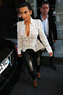 Kim Kardashian looks great in tight leather and revealing top in Paris