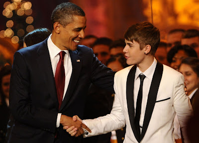 Barack Obama and Justin Bieber shaking hands