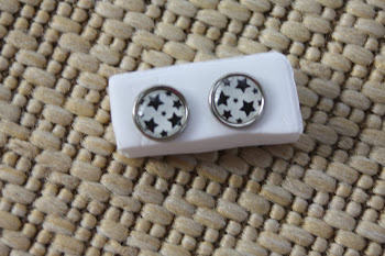 silver rimmed white with black stars